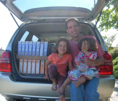 Helpers loading car for food bank